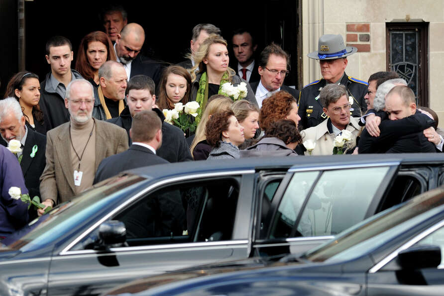 Mourner leave St. Stephen Church, in Trumbull, Conn., following a funeral mass for Mary Joy Sherlach