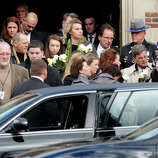 Mourner leave St. Stephen Church, in Trumbull, Conn., following a funeral mass for Mary Joy Sherlach Dec. 21st, 2012. Sherlach was a school pychologist at Sandy Hook Elementary School, in Newtown, and died in the mass shooting there last Friday.