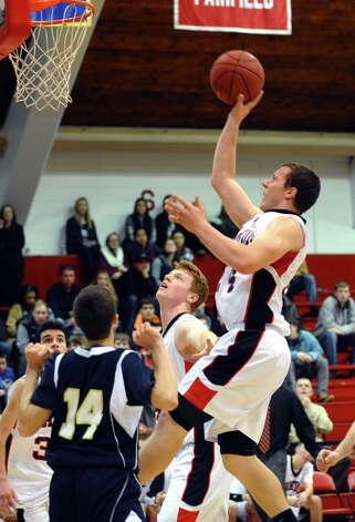 Fairfield Warde's Max Garrett looks for two points, during semifinal action of the Fairfield Prep Holiday Classic basketball tournament in Alumni Hall at Fairfield University in Fairfield, Conn. on Wednesday December 26, 2012. Photo: Christian Abraham / Connecticut Post