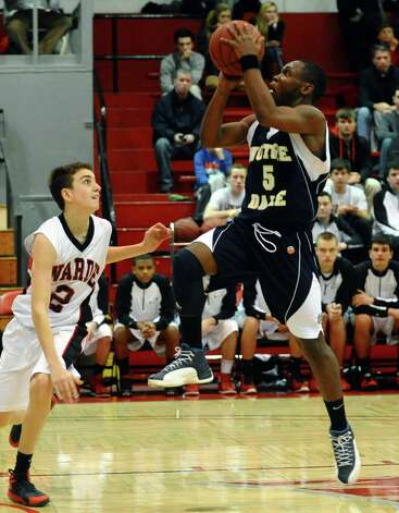 Notre Dame of Fairfield's #5 Earl Coleman goes up to the basket as Fairfield Warde's #2 Hunter Smaldone defends, during semifinal action of the Fairfield Prep Holiday Classic basketball tournament in Alumni Hall at Fairfield University in Fairfield, Conn. on Wednesday December 26, 2012. Photo: Christian Abraham / Connecticut Post