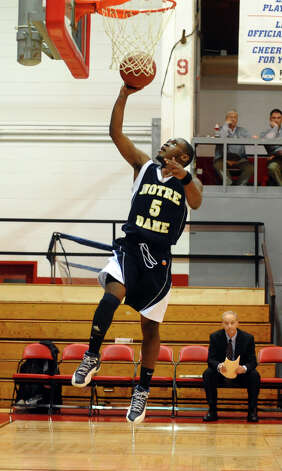 Notre Dame of Fairfield's #5 Earl Coleman lays up for an easy two points, during Fairfield Prep Holiday Classic basketball tournament semi final action against Fairfield Warde in Alumni Hall at Fairfield University in Fairfield, Conn. on Wednesday December 26, 2012. Photo: Christian Abraham / Connecticut Post
