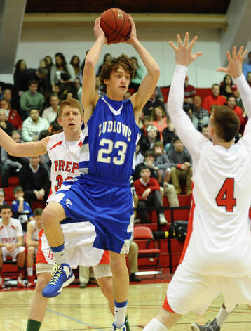 Fairfield Ludlowe's #23 Connor Peterson looks to pass the ball, during Fairfield Prep Holiday Classic basketball tournament semi final action against Fairfield Prep in Alumni Hall at Fairfield University in Fairfield, Conn. on Wednesday December 26, 2012. Photo: Christian Abraham / Connecticut Post