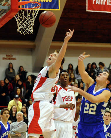 Fairfield Prep's #33 Tim Butala reaches for a rebound, during Fairfield Prep Holiday Classic basketball tournament semi final action against Fairfield Ludlowe in Alumni Hall at Fairfield University in Fairfield, Conn. on Wednesday December 26, 2012. Photo: Christian Abraham / Connecticut Post