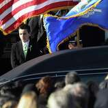 Mourners depart the funeral of slain teacher Victoria Soto, 27, at the Lordship Community Church on December 19, 2012 in Stratford, Connecticut. The first grade teacher died while reportedly trying to protect her students during last Friday's shooting massacre at Sandy Hook Elementary School in Newtown.  (Photo by John Moore/Getty Images)