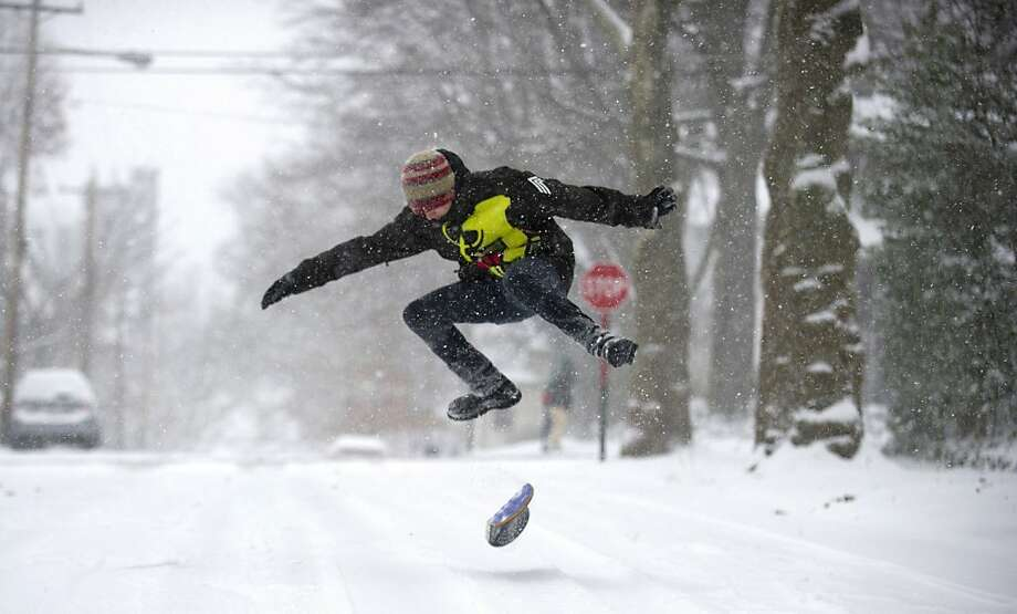 Chandler Fescemeyer, 17, snowboards down the road after a winter storm blanketed the Midwest with snow December 26, 2012 in Pittsburgh, Pennsylvania. The storm has moved west from the Sierra Nevada across the Midwest and will head to the East Coast today. Photo: Jeff Swensen, Getty Images