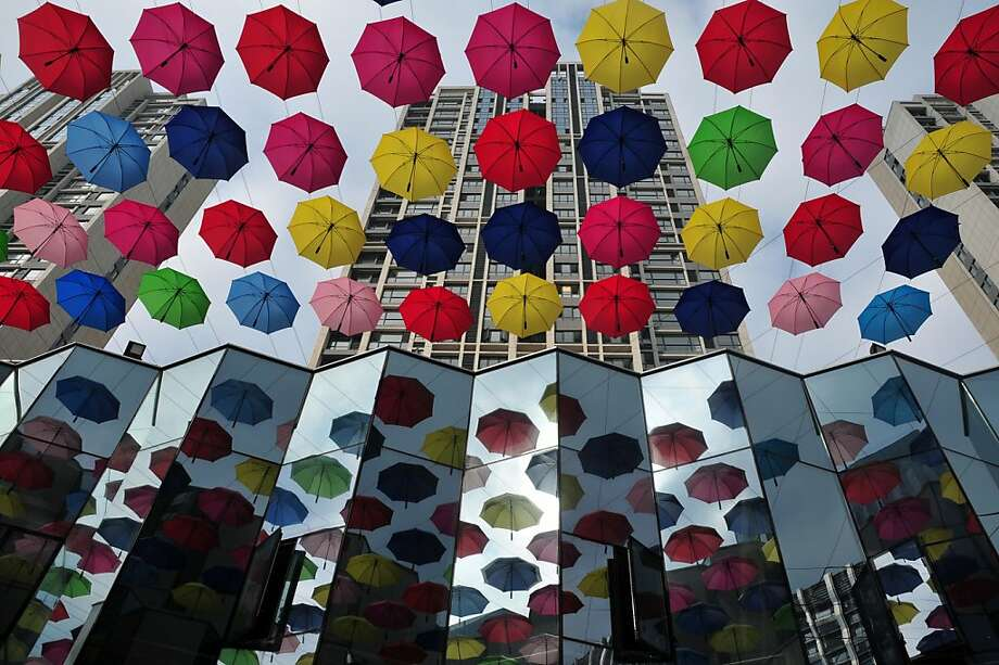 This picture taken on December 25, 2012 shows umbrellas hanging over a commercial street in Fuzhou, south China's Fujian province. China will make increasing domestic demand a top priority in 2013, state media said on December 16 following a key conference that sets the country's economic goals. Photo: Str, AFP/Getty Images