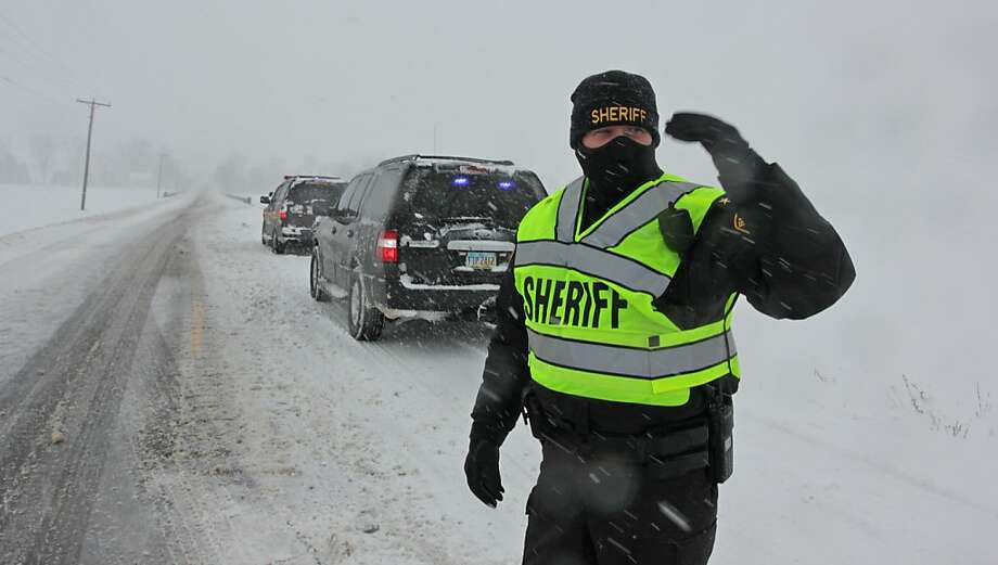Union County Sheriff Jamie Patton directs traffic around an accident on Rt. 4 north of Marysville, Ohio Wednesday afternoon Dec. 26, 2012.  Nobody was injured in the incident. Photo: Doral Chenoweth III, Associated Press