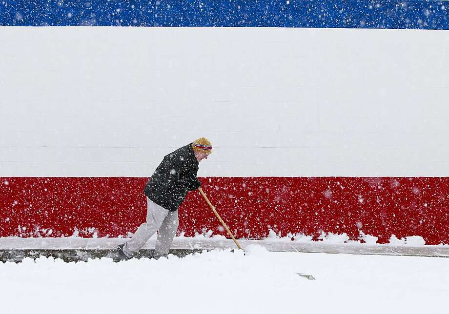 Dan Switzer, owner of the Dairy Queen on Bechtle Avenue, shovels snow although the store was closed due to the weather on Wednesday, Dec. 26, 2012, in Springfield, Ohio. Photo: Barbara J. Perenic, Associated Press