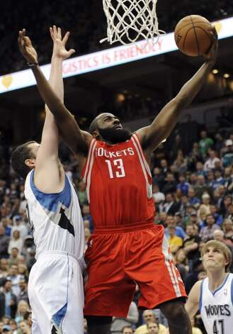 Dec. 26: Rockets 87, Timberwolves 84James Harden (13) shoots a layup as Kevin Love defends. (Jim Mone / Associated Press)