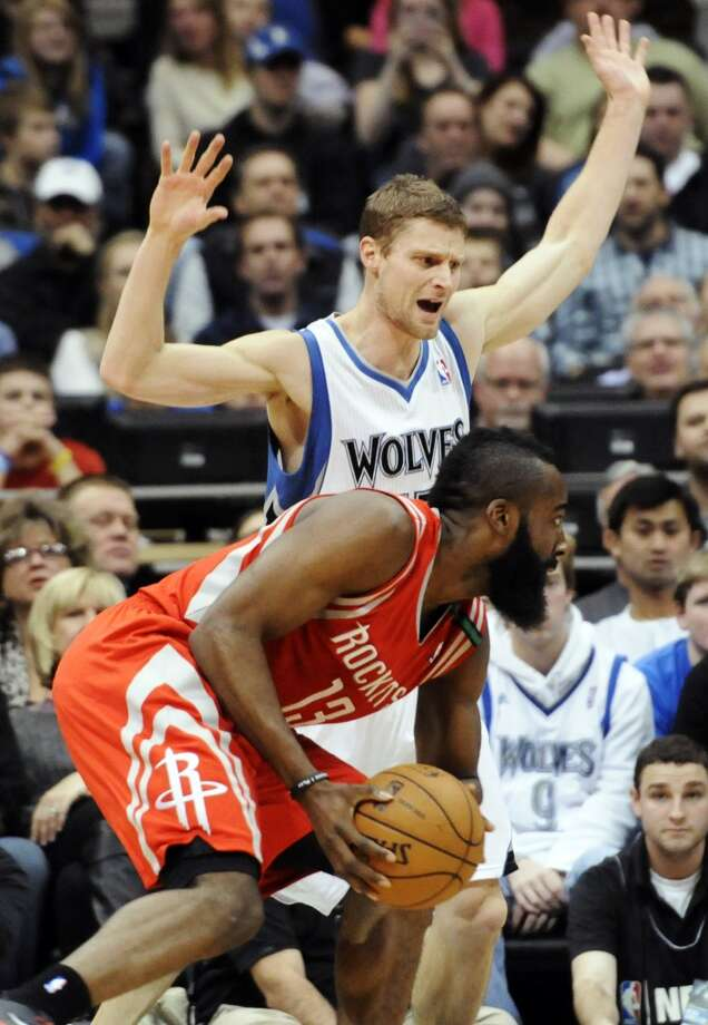 James Harden (13) drives against Luke Ridnour in the first half. (Jim Mone / Associated Press)