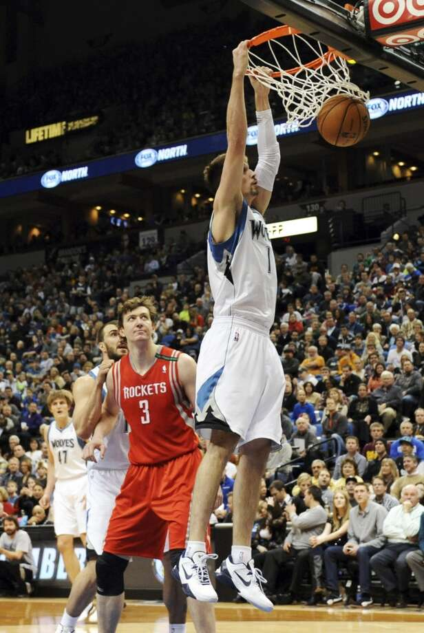Alexey Shved, of Russia, dunks against Omer Asik (3), of Turkey, in the first half. (Jim Mone / Associated Press)
