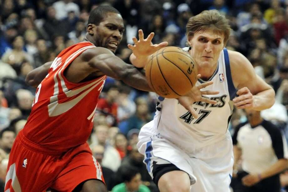 Toney Douglas, left, and Andrei Kirilenko, of Russia, chase the ball. (Jim Mone / Associated Press)