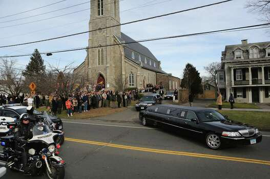 Family members depart the Trinity Episcopal Church following a funeral for for Benjamin Wheeler, 6, on December 20, 2012 in Newtown, Connecticut. Benjamin, a member of Tiger Scout Den 6, was killed when 20 children and six adults were massacred at Sandy Hook Elementary School last Friday. Six services were held for students and teachers in the Newtown area Thursday.  (Photo by John Moore/Getty Images) Photo: John Moore, Getty Images / 2012 Getty Images