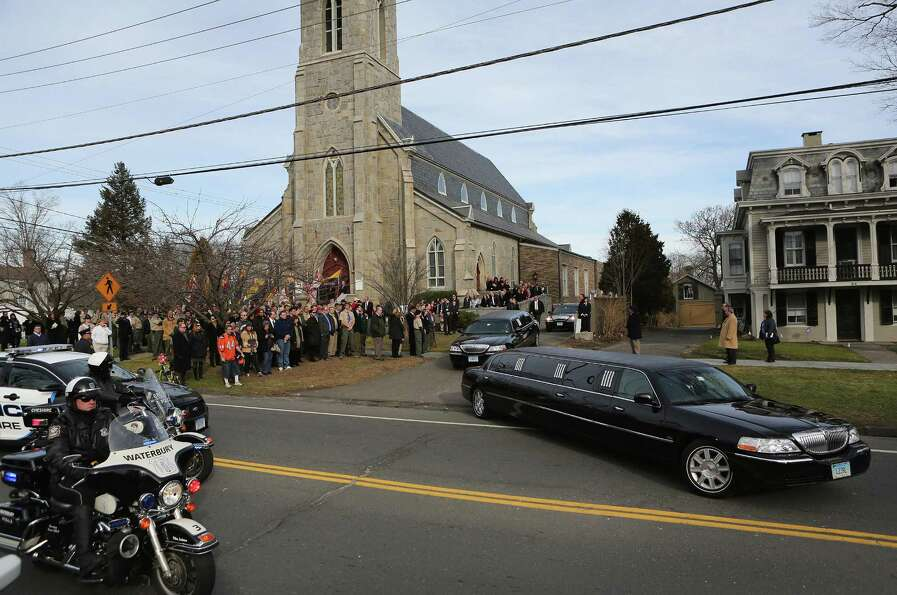 Family members depart the Trinity Episcopal Church following a funeral for for Benjamin Wheeler, 6,