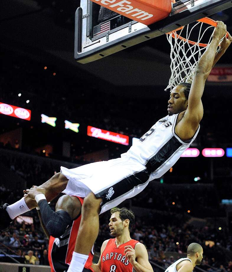 Kawhi Leonard of the Spurs dunks against the Toronto Raptors at the AT&T Center on Wednesday, Dec. 26, 2012. Photo: Billy Calzada, San Antonio Express-News / SAN ANTONIO EXPRESS-NEWS