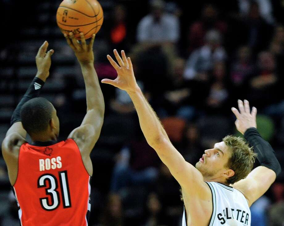 Tiago Splitter of the Spurs (22) defends as Terrence Ross (31) of the Toronto Raptors shoots during first-half action at the AT&T Center on Wednesday, Dec. 26, 2012. Photo: Billy Calzada, San Antonio Express-News / SAN ANTONIO EXPRESS-NEWS