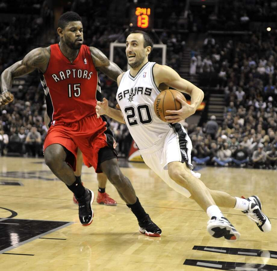Spurs guard Manu Ginobili (right) drives against Toronto Raptors forward Amir Johnson during the first half on Wednesday, Dec. 26, 2012, in San Antonio. Photo: Bahram Mark Sobhani, Associated Press / FR91484 AP