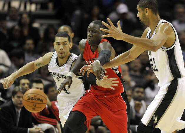 Toronto Raptors forward Mickael Pietrus (center) steals the ball from the Spurs' Danny Green (left) and Tim Duncan (right) during the second half on Wednesday, Dec. 26, 2012, in San Antonio. The Spurs defeated the Raptors 100-80. Photo: Bahram Mark Sobhani, Associated Press / FR91484 AP