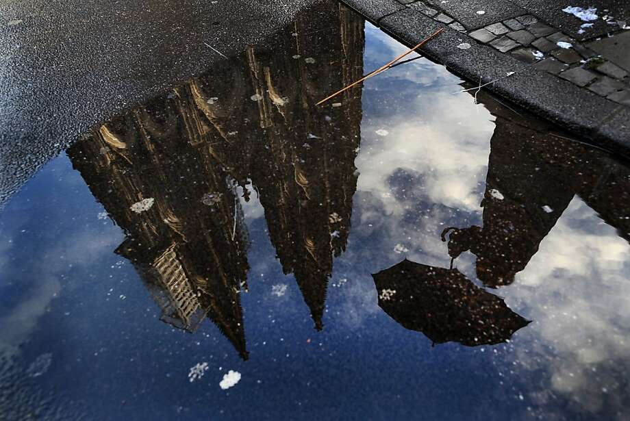 Cologne's landmark the Cathedral reflects in a puddle in Cologne, western Germany on December 25, 2012. Photo: Martin Gerten, AFP/Getty Images