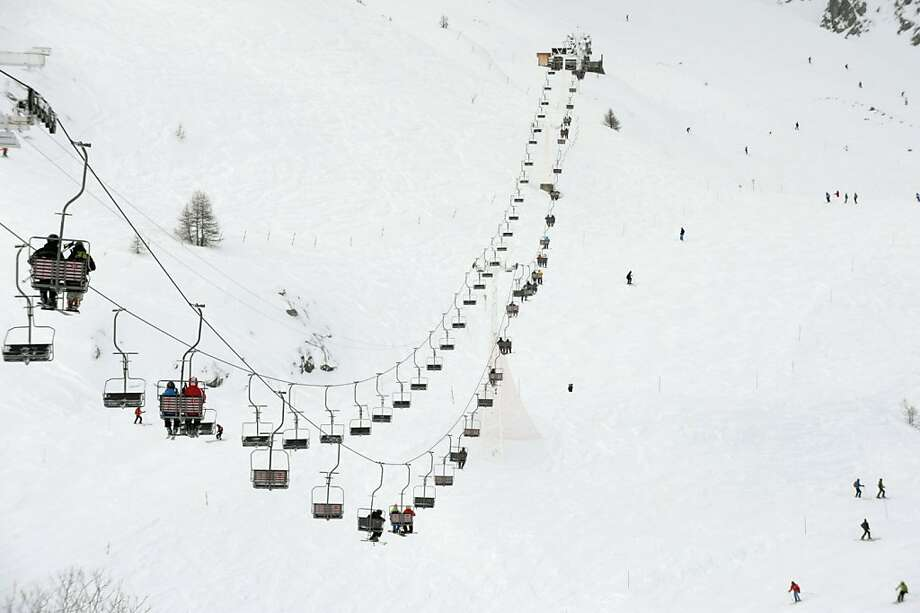 Skiers ride a chair-lift  at the Grands Monets slopes part of the Mont-Blanc mountain chain on December 26, 2012 in the Chamonix valley, French Alps. Photo: Jean-pierre Clatot, AFP/Getty Images