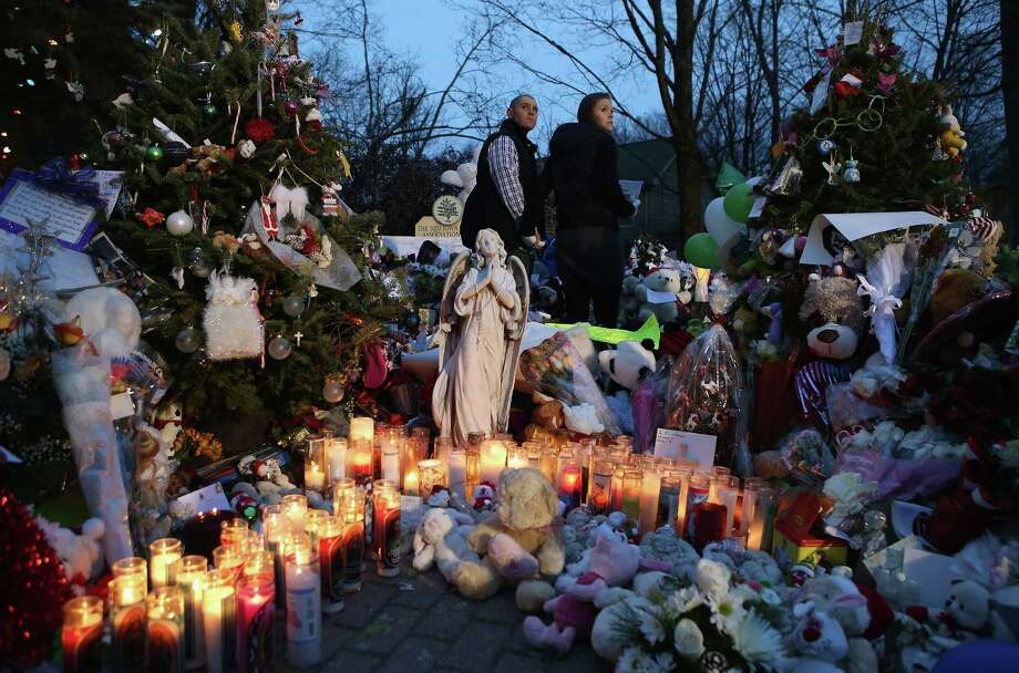 As mourners in Newtown, Conn., and around the world continue to grieve over the shooting victims, a reader  says gun control is not the answer to eliminating such tragedies. Photo: John Moore, Getty Images / 2012 Getty Images