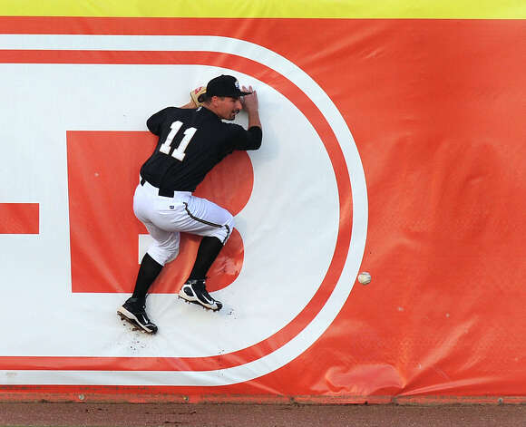 San Antonio Missions left fielder Dean Anna crashes into the wall as he is unable to run down a fly ball that went for a double during Texas League action against the Midland Rockhounds at Wolff Stadium on Thursday, July 12, 2012. Photo: Billy Calzada, San Antonio Express-News / © 2012 San Antonio Express-News