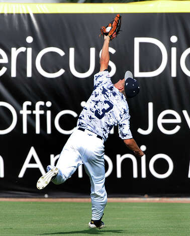 Boerne Champion centerfielder Austin Ley makes a running catch of a long fly ball during Class 4A regional finals baseball action against Lake Travis at Wolff Stadium on Saturday, June 2, 2012. Photo: Billy Calzada, San Antonio Express-News / © 2012 San Antonio Express-News