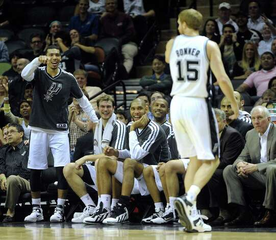 Danny Green, left, Tiago Splitter, Tim Duncan and Boris Diaw of the San Antonio Spurs react after Matt Bonner, (15) dunked the ball against the Houston Rockets during second-half NBA action at the AT&T Center on Friday, Dec. 7, 2012. Photo: Billy Calzada, San Antonio Express-News / SAN ANTONIO EXPRESS-NEWS