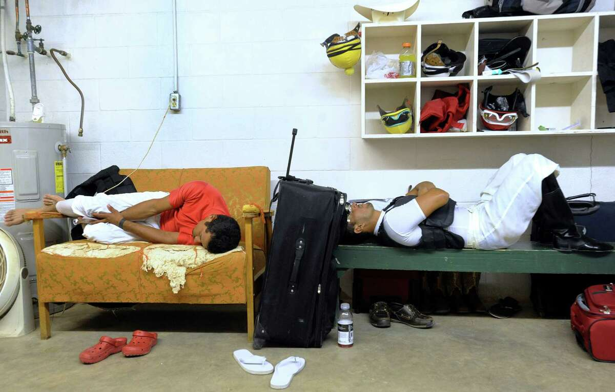Cipriano Oscanga and Victor Perez, right, jockeys at the Gillespie County Fairgrounds in Fredericksburg, Texas, cool off and relax between races on Saturday, July 7, 2012. Click to browse all of the EN's most memorable photos of 2012