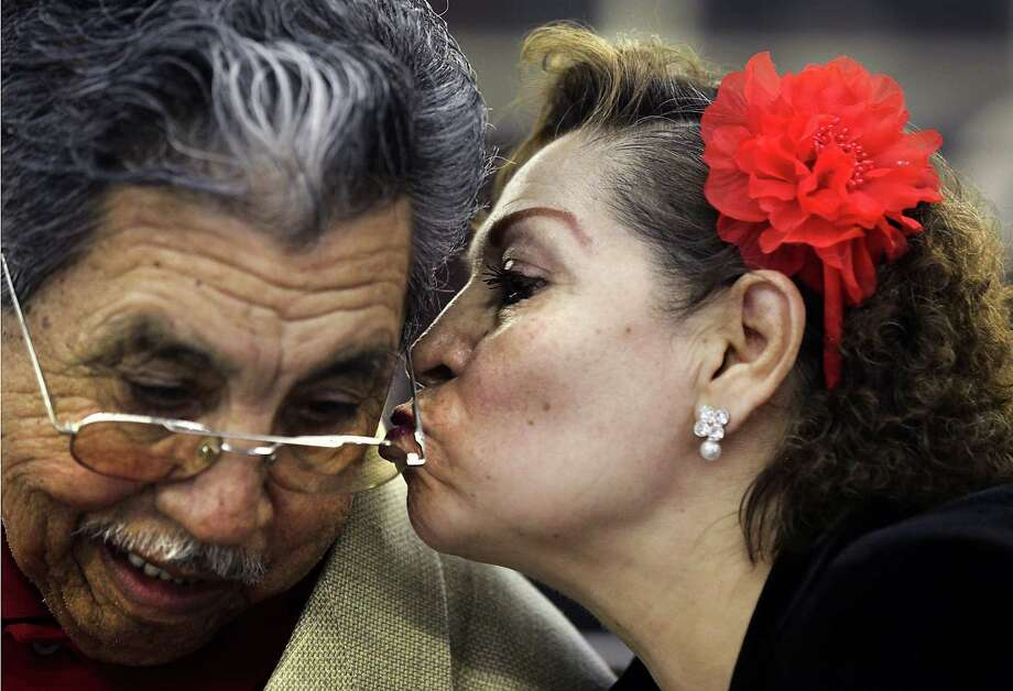 """Pauline Luna gives Pete Valdillez a kiss on the cheek at the District 1 Senior Sweetheart Dance at Plaza del Rey Ballroom. """"Yes, he's my sweetheart, a very nice man"""", Luna said. Area seniors enjoyed lunch, a raffle, and dancing to The OBG Band. Monday, Feb. 13, 2012. Photo: BOB OWEN, San Antonio Express-News / © 2012 San Antonio Express-News"""