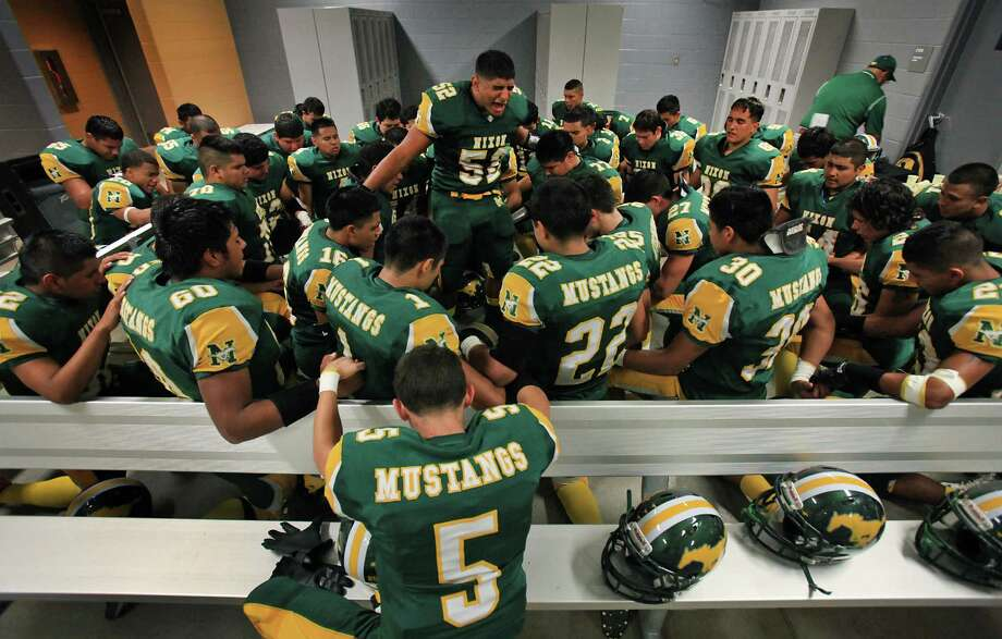 Erick Fernandez, Captain of the Nixon High School football team, leads his team in prayer before their game against Corpus Christi Ray at Shirley Field in Laredo, Friday, Oct. 5, 2012. Photo: BOB OWEN, San Antonio Express-News / © 2012 San Antonio Express-News