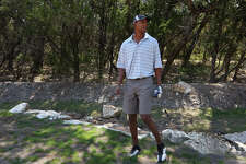 Former San Antonio Spurs player Sean Elliott practices his golf game at his home in north central San Antonio, Monday, Sept. 12, 2011.