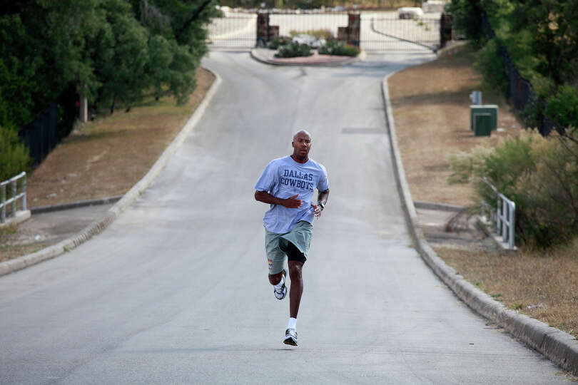 Bruce Bowen does stride work outside his home in San Antonio on Friday, Nov. 12, 2010.