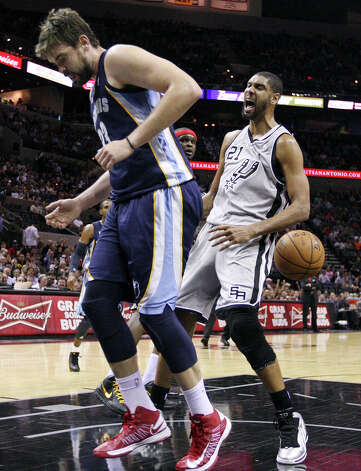 San Antonio Spurs' Tim Duncan reacts after dunking over Memphis Grizzlies' Marc Gasol during first half action Saturday Dec. 1, 2012 at the AT&T Center. Photo: Edward A. Ornelas, San Antonio Express-News / © 2012 San Antonio Express-News