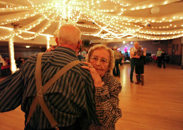 Harold Seiler, 82, (left) and Irene Seiler, 88, dance to the music of the San Antonio Combo at the Martinez Social Club Sunday July 22, 2012 during the 100th anniversary celebration. Photo: Edward A. Ornelas, San Antonio Express-News / © 2012 San Antonio Express-News