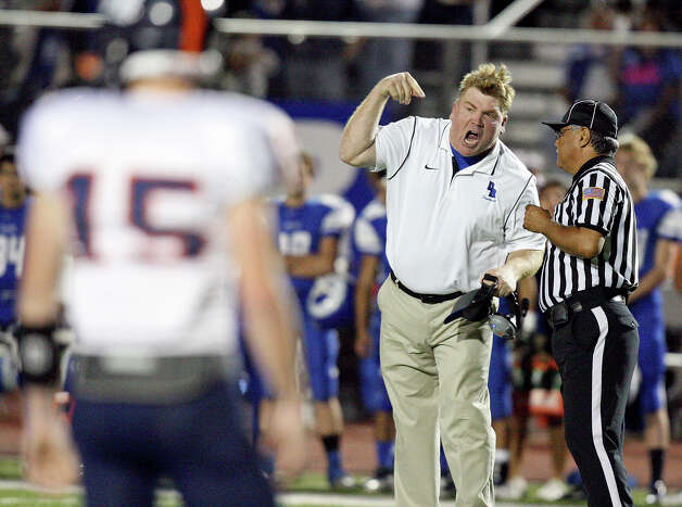 Del Rio head coach Stephen Hoffman (center) reacts after a player was ejected from the game for a personal foul during first half action against Brandeis Friday Nov. 30, 2012 at Eagle Pass ISD Stadium in Eagle Pass, Tx. Photo: Edward A. Ornelas, San Antonio Express-News / © 2012 San Antonio Express-News