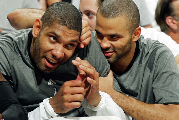 San Antonio Spurs Tim Duncan (left) and teammate Tony Parker joke on the bench near the end of Game 1 of the Western Conference first round with the Utah Jazz  Sunday April 29, 2012 at the AT&T Center. The Spurs won 106-91. Photo: EDWARD A. ORNELAS, San Antonio Express-News / © SAN ANTONIO EXPRESS-NEWS (NFS)