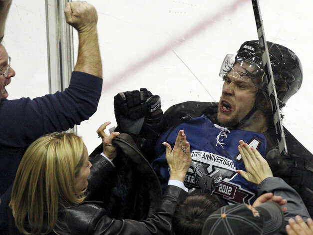Rampage's Bracken Kearns celebrates with fans after scoring a goal against the IceHogs during third period action Saturday Jan. 14, 2012 at the AT&T Center. The Rampage won 2-1. Photo: EDWARD A. ORNELAS, San Antonio Express-News / SAN ANTONIO EXPRESS-NEWS (NFS)