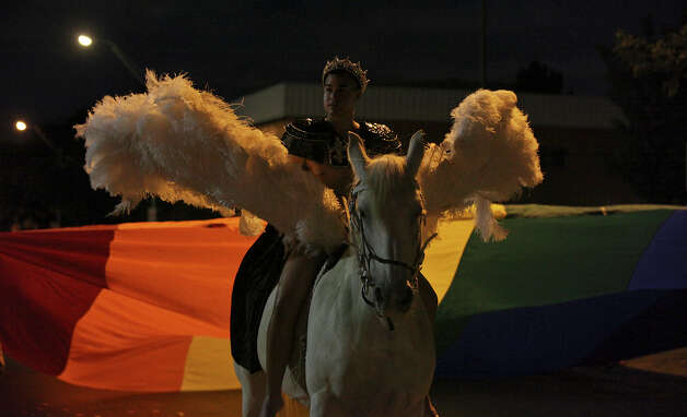 Steven Olague as, Zeus, and the horse Blair, as Pegasus, take part in the Pride Bigger Than Texas Festival & Parade held Saturday June 30, 2012. Photo: Edward A. Ornelas, San Antonio Express-News / © 2012 San Antonio Express-News