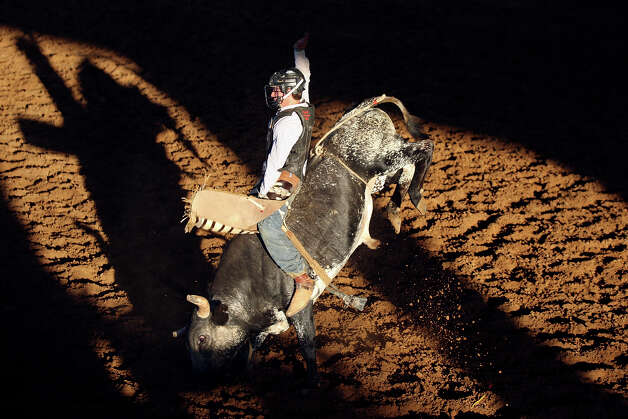 Winston Lopez, from Bandera, Tx., competes in the bull riding event during the Buck up for Leon benefit held Friday June 15, 2012 at Tejas Rodeo Arena in Bulverde, Tx. Tejas Rodeo will host events Friday and Saturday to raise funds to offset medical expenses for Coffee, who contracted spinal meningitis after spine surgery in March. Lopez scored a 75 on the ride.Click to browse all of the EN's most memorable photos of 2012  Photo: Edward A. Ornelas, San Antonio Express-News / © 2012 San Antonio Express-News