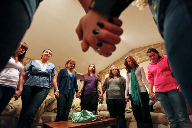 Women pray during a meeting of Lavish Ministry at Kayla Moilanen's home Thursday Nov. 29, 2012. Photo: Edward A. Ornelas, San Antonio Express-News / © 2012 San Antonio Express-News