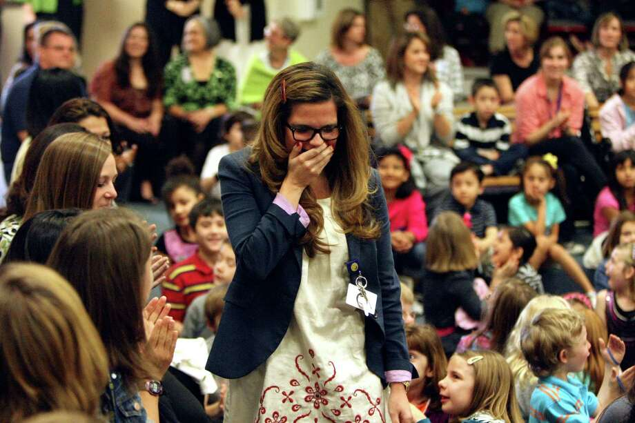Woodridge Elementary School teacher Lesley Balido-Dean a first through fifth grade bilingual and immersion specialist is surprised with an H-E-B Excellence in Education Awards on Monday March 5, 2012.  Six local teachers will get $1,000 for themselves and another for their school. Two local principals will get $1,000 for themselves and $2,500 for their school. Two local principals will get $1,000 for themselves and $2,500 for their school. Photo: HELEN L. MONTOYA, San Antonio Express-News / ©SAN ANTONIO EXPRESS-NEWS