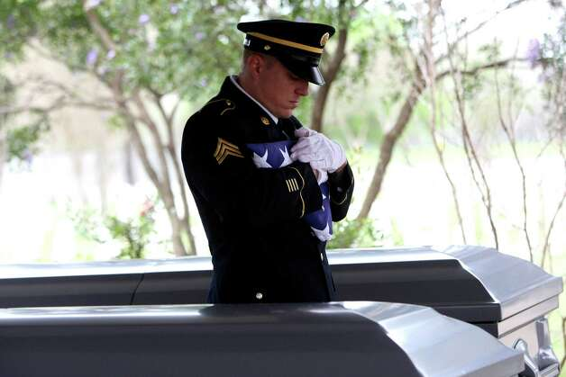 Sgt Paul Querbach folds an American flag during a memorial service for Albert Lee Renfro and Everardo Alvarez-Lara.  The two veterans were given military services through the Dignity Memorial Homeless Veterans Memorial Program on Wednesday, March 8 at Fort Sam Houston National Cemetery. Burials for forgotten veterans are held there and at VA cemeteries elsewhere around the country. Texas also has established four state veterans' cemeteries.  The government provides a government headstone or marker, a U.S. burial flag and perpetual care of the gravesite for these veterans buried in a VA cemetery.Click to browse all of the EN's most memorable photos of 2012  Photo: HELEN L. MONTOYA, San Antonio Express-News / ©SAN ANTONIO EXPRESS-NEWS