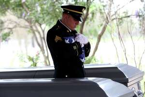 Sgt Paul Querbach folds an American flag during a memorial service for Albert Lee Renfro and Everardo Alvarez-Lara.  The two veterans were given military services through the Dignity Memorial Homeless Veterans Memorial Program on Wednesday, March 8 at Fort Sam Houston National Cemetery. Burials for forgotten veterans are held there and at VA cemeteries elsewhere around the country. Texas also has established four state veterans' cemeteries.  The government provides a government headstone or marker, a U.S. burial flag and perpetual care of the gravesite for these veterans buried in a VA cemetery.