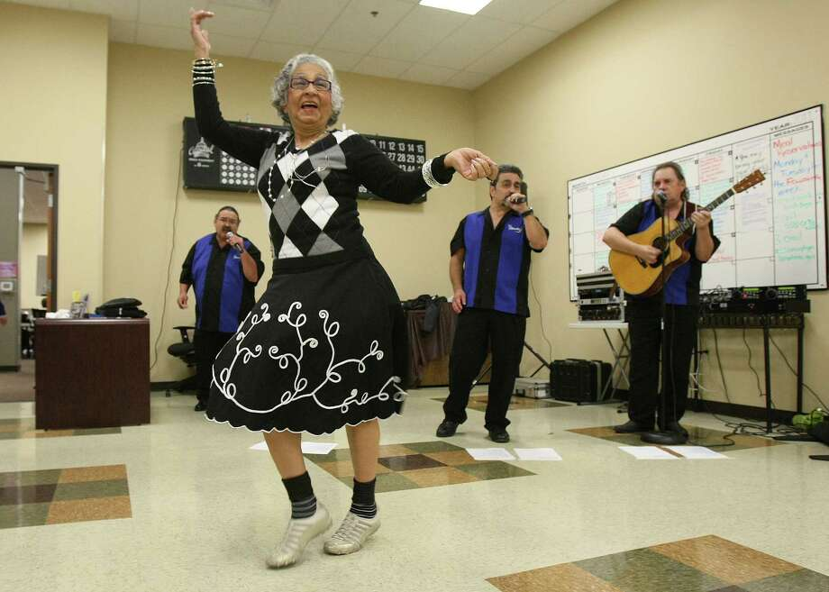 "Camelia Watts, 75, dances during the New Year Sock Hop at the Lopez Senior One-Stop Center on Monday Jan 9, 2012. Watts, who suffered a stroke in March 2011 said her doctor told her dancing was the best exercise for her to get both a physical and mental workout. ""I love dancing, I'll dance flamenco, the charleston, whatever is playing.""  The event featuring nationally acclaimed Doo-Wop Singers The Moonlites. WellMed Physician and Doo-Wop singer Dr. Jose DeJesus joined in with the group and sang a few songs. Photo: HELEN L. MONTOYA, San Antonio Express-News / SAN ANTONIO EXPRESS-NEWS"