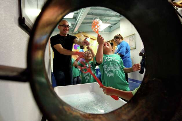 Kids explore Hill Country Bubble Ranch at the San Antonio Children's Museum on Thursday May 3, 2012. Photo: HELEN L. MONTOYA, San Antonio Express-News / ©SAN ANTONIO EXPRESS-NEWS