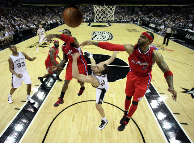 San Antonio Spurs' Manu Ginobili (20)  is fouled going to the basket by  Los Angeles Clippers' Kenyon Martin (2) with  Los Angeles Clippers' Eric Bledsoe (12) in pursuit during the second half of game two of the Western Conference semifinals at AT&T Center, Thursday, May 17, 2012.  The Spurs won 105-88. Photo: Jerry Lara, San Antonio Express-News / © San Antonio Express-News