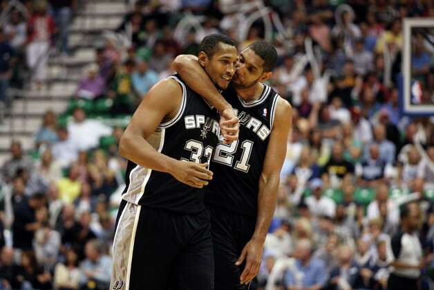 San Antonio Spurs Boris Diaw and Tim Duncan celebrate as they take a commanding lead during the fourth quarter against  Utah Jazz in game three of the Western Conference first round at EnergySolutions Arena in Salt Lake City,  Saturday, May 5, 2012.  The Spurs won 102-90 and lead the series 3-0. Photo: Jerry Lara, San Antonio Express-News / © San Antonio Express-News