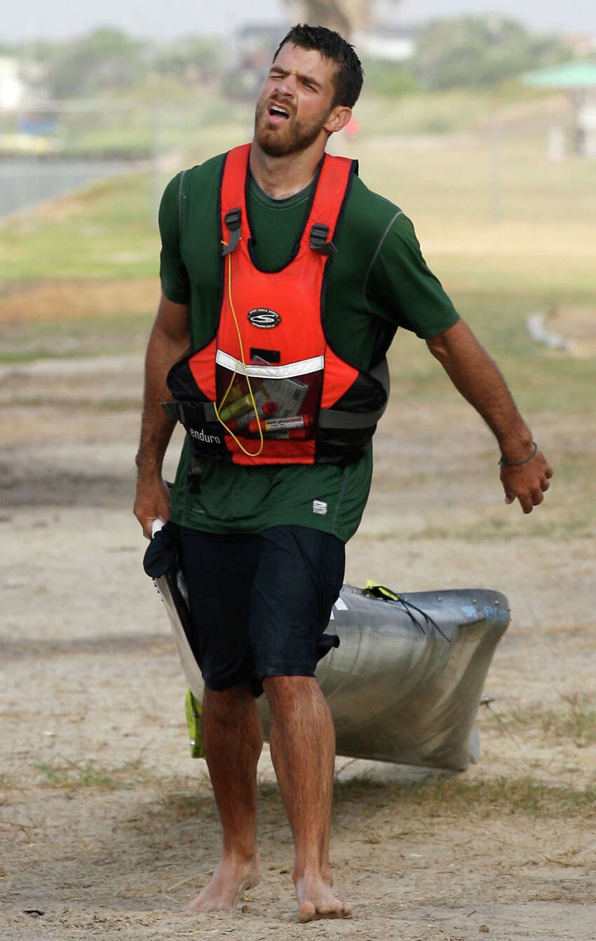 Andrew Condie drags his canoe the last quarter mile after getting out of the San Antonio Bay during the 2012 Texas Water Safari canoe race, Monday, June 11, 2012. Allowed by rules, Condie was able to finished in 12th place overall.