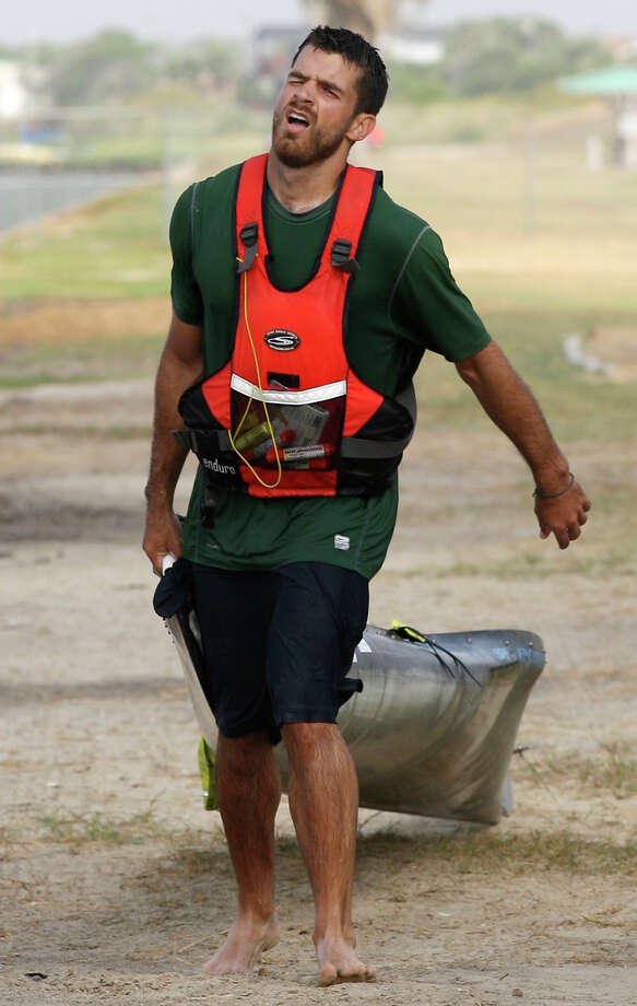 Andrew Condie drags his canoe the last quarter mile after getting out of the San Antonio Bay during the 2012 Texas Water Safari canoe race, Monday, June 11, 2012. Allowed by rules, Condie was able to finished in 12th place overall. Photo: Jerry Lara, San Antonio Express-News / © 2012 San Antonio Express-News